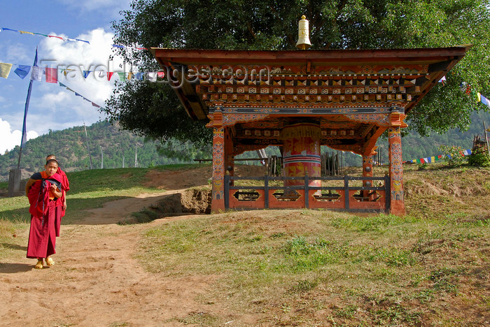 bhutan434: Bhutan, Punakha, Monks and large outdoor prayer wheel - photo by J.Pemberton - (c) Travel-Images.com - Stock Photography agency - Image Bank