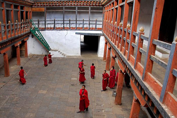 bhutan436: Bhutan, Punakha, Monks in courtyard of Wangdue Phodrang Dzong - photo by J.Pemberton - (c) Travel-Images.com - Stock Photography agency - Image Bank