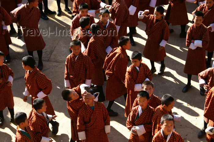 bhutan67: Bhutan - Paro: school - wearing ghos - national dress for Bhutanese men - introduced in the 17th century by Shabdrung Ngawang Namgyel - photo by A.Ferrari - (c) Travel-Images.com - Stock Photography agency - Image Bank