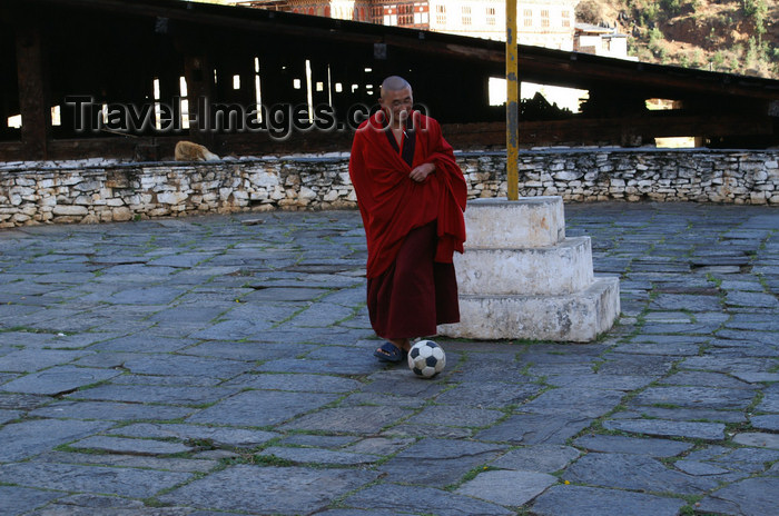 bhutan71: Bhutan - Paro: monk playing football - outside the Paro Dzong - photo by A.Ferrari - (c) Travel-Images.com - Stock Photography agency - Image Bank
