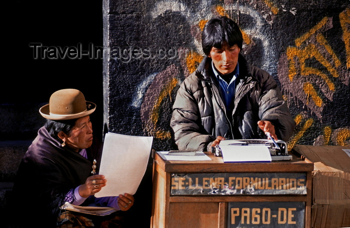 bolivia130: La Paz, Bolivia: street scribe types a letter for an illeterate Aymara woman - photo by C.Lovell - (c) Travel-Images.com - Stock Photography agency - Image Bank