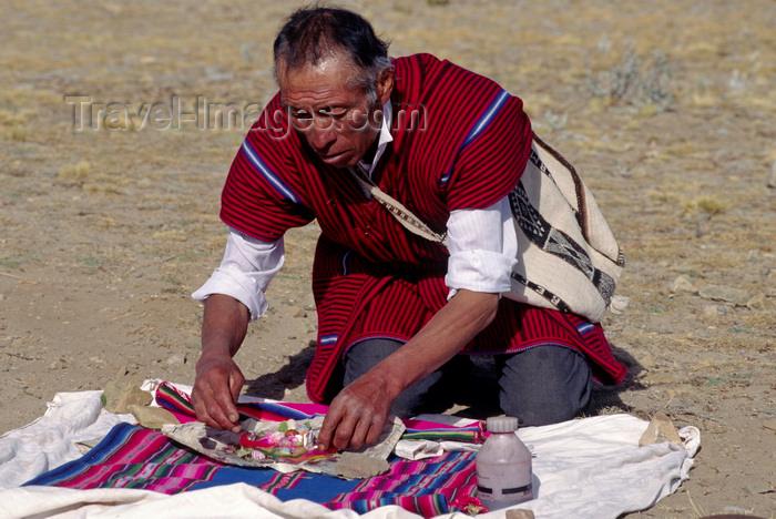 bolivia150: Isla del Sol, Lake Titicaca, Manco Kapac Province, La Paz Department, Bolivia: a kallawayas (shaman) performs a koada (offering) to Pancha Mama (Mother Earth) - photo by C.Lovell - (c) Travel-Images.com - Stock Photography agency - Image Bank