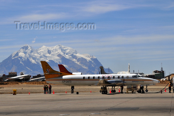 bolivia27: El Alto, La Paz department, Bolivia: La Paz El Alto International Airport - LPB - Amaszonas Fairchild SA-227CC Metro 23 - Fairchild Swearingen Metroliner - mount Illimani and old aircraft in the background - CP-2473 - cn DC-842B - photo by M.Torres - (c) Travel-Images.com - Stock Photography agency - Image Bank