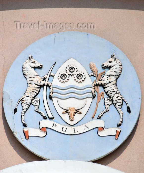 botswana43: Gaborone, South-East District, Botswana: Coat of arms of Botswana - shiled with cog wheels, waves and bull's head - zebras holding elephant's tusks - 'Pula' means rain - National Assembly of Botswana - Government Enclave - photo by M.Torres - (c) Travel-Images.com - Stock Photography agency - Image Bank
