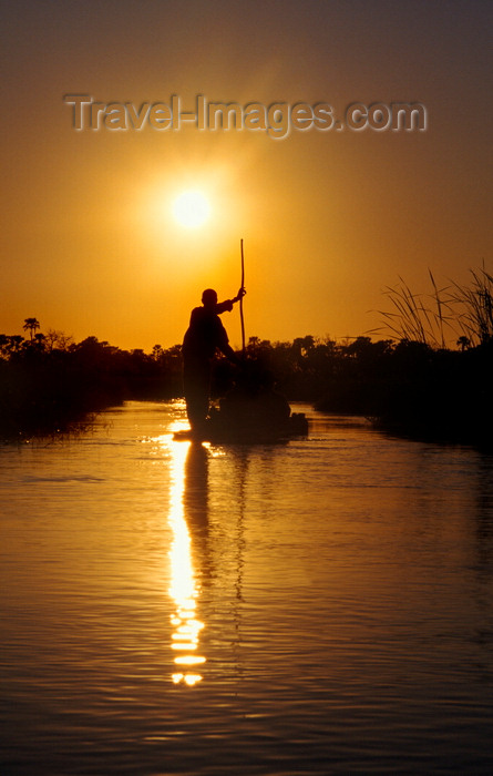 botswana61: Okavango delta, North-West District, Botswana: Mokoro dugout canoe at sunset - punting - photo by C.Lovell - (c) Travel-Images.com - Stock Photography agency - Image Bank