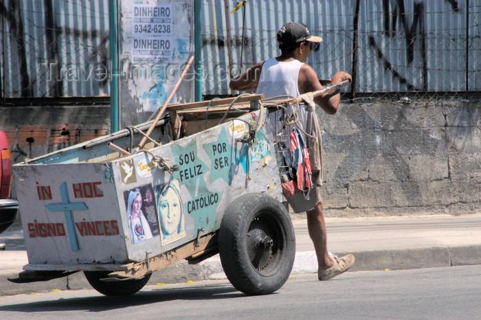 brazil129: Brazil / Brasil - São Paulo: religion and money - man with cart - Rio Pequeno avenue / religião e dinheiro - Avenida do Rio Pequeno - Zona Oeste (photo by M.Alves) - (c) Travel-Images.com - Stock Photography agency - Image Bank
