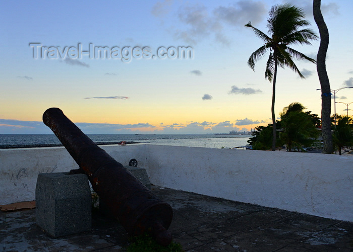 brazil162: Olinda, Pernambuco, Brazil: Fort of St Francis at sunset - cannon aimed at the ocean - 17th century Portuguese fortress built by Cristóvão Álvares - Recife in the distance - Fortim square - Forte de São Francisco (Fortim do Queijo) - photo by M.Torres - (c) Travel-Images.com - Stock Photography agency - Image Bank