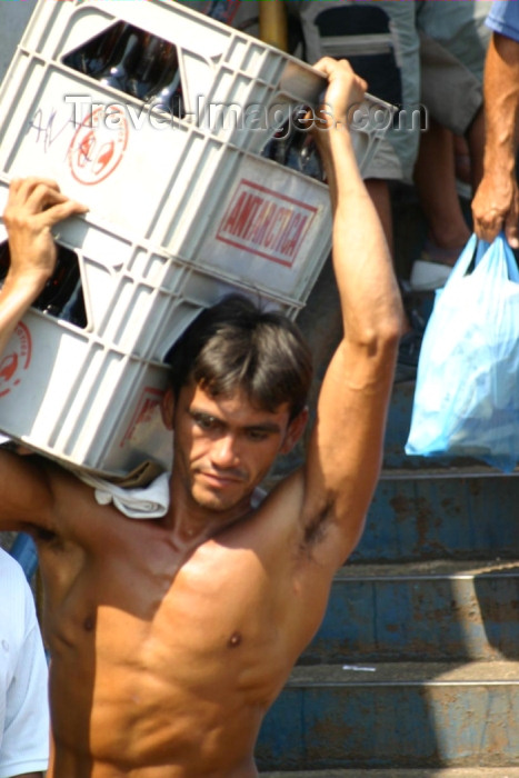 brazil178: Brazil / Brasil - Manaus: loading boxes - Antarctica beer - muscular man - carregando grades de cerveja Antarctica  (photo by N.Cabana) - (c) Travel-Images.com - Stock Photography agency - Image Bank