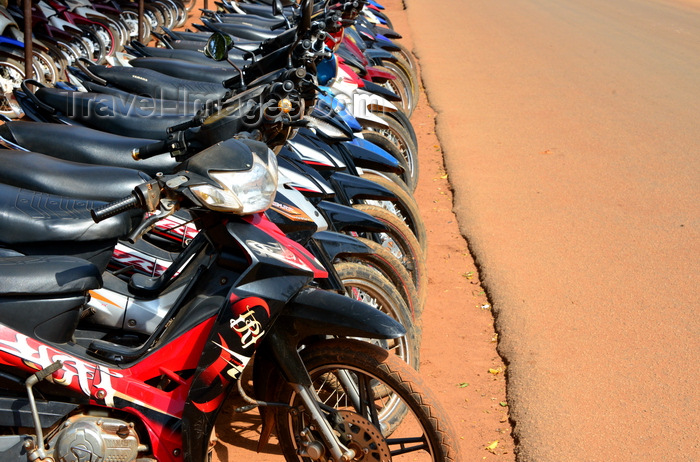 burkina-faso32: Ouagadougou, Burkina Faso: parked motorbikes and asphalt covered in red dust - photo by M.Torres - (c) Travel-Images.com - Stock Photography agency - Image Bank