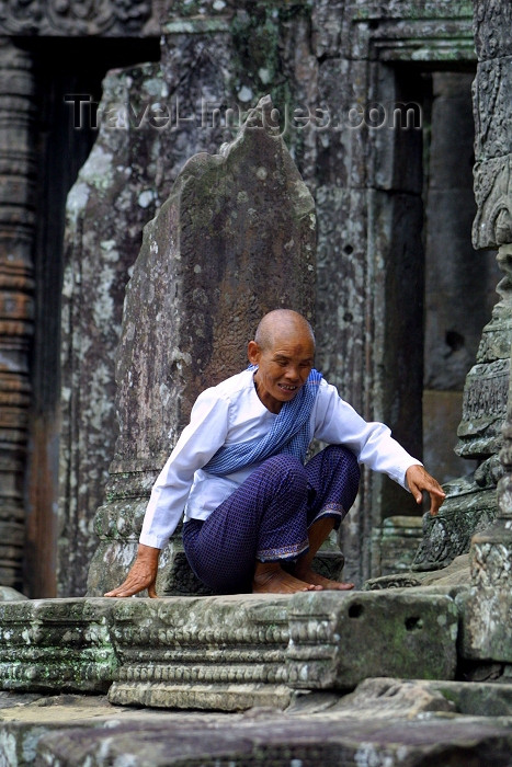 cambodia102: Angkor, Cambodia / Cambodge: Bayon temple - an ascetic monk burns incense - photo by R.Eime - (c) Travel-Images.com - Stock Photography agency - Image Bank