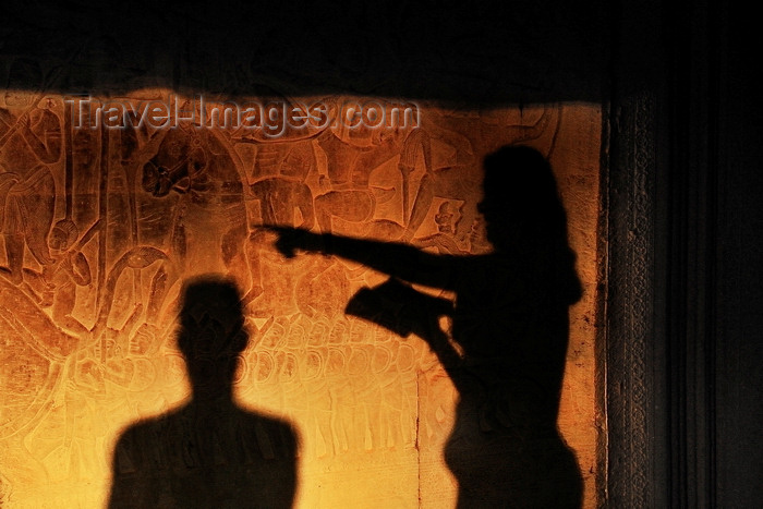 cambodia130: Angkor, Cambodia: Angkor Wat - visitors shadows over the bas-reliefs showind the army of Suryavarman II - photo by J.Hernández - (c) Travel-Images.com - Stock Photography agency - Image Bank