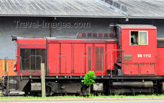 cameroon54: Cameroon, Douala: Alsthom locomotive on the railway line serving Douala harbour, with port warehouses in the background - Boulevard du Général Leclerc 27 Août 1940 - Douala harbor handles most of the country's imports and export  - photo by M.Torres - (c) Travel-Images.com - Stock Photography agency - Image Bank