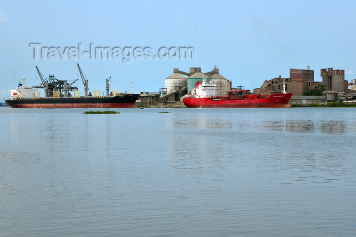 cameroon56: Cameroon, Douala: harbor scene - freighter ships and port installations - silos and warehouses, Cimencam cement grinding station and import terminal - Ports Authority Douala - photo by M.Torres - (c) Travel-Images.com - Stock Photography agency - Image Bank
