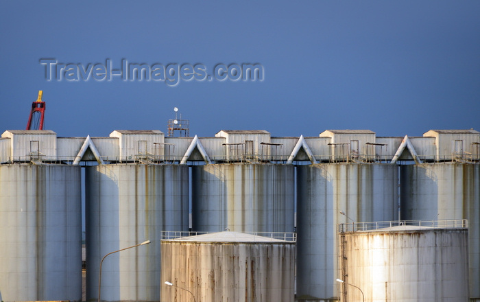 cameroon89: Cameroon, Douala: silos connected by a conveyor belt at the harbor - two oil tanks in the foreground - the conveyor belts is supported by one element trusses - photo by M.Torres - (c) Travel-Images.com - Stock Photography agency - Image Bank
