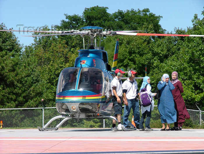 canada162: Niagara Falls, Ontario, Canada / Kanada: veiled women and Niagara Helicopters Bell 407 - helicopter rides around the Niagara falls - photo by R.Grove - (c) Travel-Images.com - Stock Photography agency - Image Bank