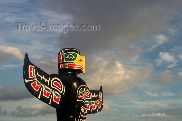 canada3: Vancouver, BC, Canada: colorful totem pole against dramatic cloudy sky - carved by native Indian Wade Baker, Skyspirit Studios, North Vancouver - Property released - photo by D.Smith - (c) Travel-Images.com - Stock Photography agency - Image Bank