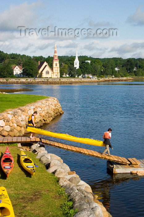 canada349: Kayaks and kayakers in the forground and the hisitoric three churches of Mahone Bay, Nova Scotia, Canada in the background - photo by D.Smith - (c) Travel-Images.com - Stock Photography agency - Image Bank