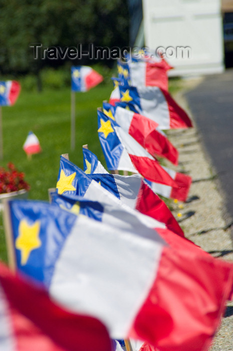 canada355: Scenic view Acadian flags during the 400th anniversary of the landing of the French in North America in Acadian region near Pubnico in western Nova Scotia, Canada - photo by D.Smith - (c) Travel-Images.com - Stock Photography agency - Image Bank