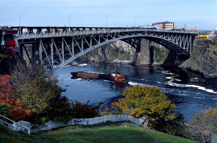 canada369: New Brunswick, Canada: tugboat pushing barge down the St. Lawrence - arch bridge - photo by C.Lovell - (c) Travel-Images.com - Stock Photography agency - Image Bank