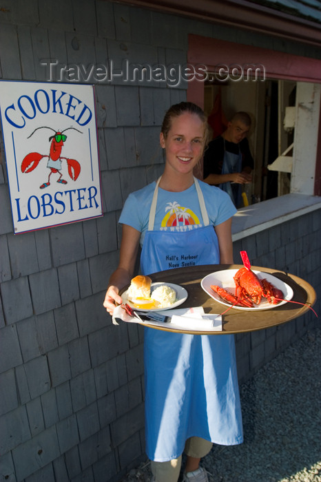canada410: Waitress serving lobster at a restaurant in the fishing village of Halls Harbour, Nova Scotia, Canada. Model released. - photo by D.Smith - (c) Travel-Images.com - Stock Photography agency - Image Bank