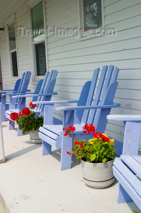 canada421: Victoria house showing porch and purple chairs in Acadian region of Nova Scotia, Canada - photo by D.Smith - (c) Travel-Images.com - Stock Photography agency - Image Bank