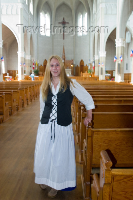canada425: Young woman drssed in Acadian custume in a church in Metaghan, Acadian region of Nova Scotia, Canada - photo by D.Smith - (c) Travel-Images.com - Stock Photography agency - Image Bank