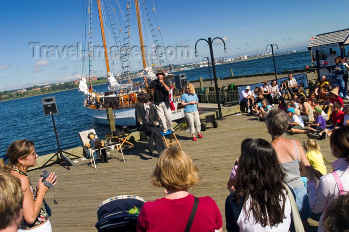 canada440: Tourists watching street buskers at the hirtoric waterfront pier in Halifax, Noca, Scotia, Canada - photo by D.Smith - (c) Travel-Images.com - Stock Photography agency - Image Bank