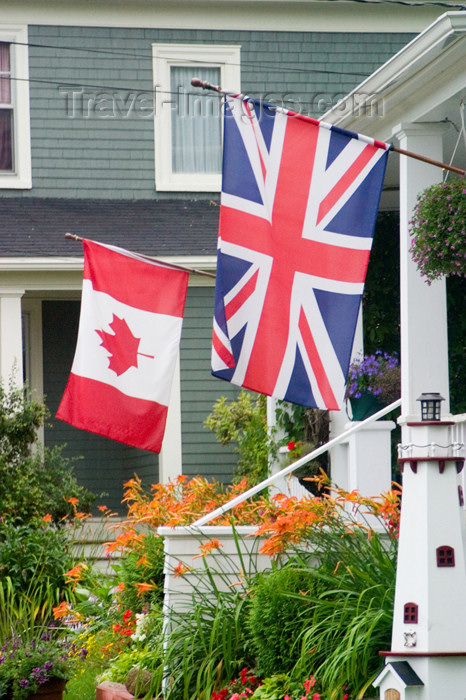 canada455: Close-up view of a Canadian and America flag at a home in historic Mahone Bay, Nova Scotia, Canada - photo by D.Smith - (c) Travel-Images.com - Stock Photography agency - Image Bank