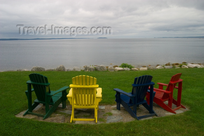canada458: Close-up of 4 colourful Aderondack chairs and a view of the Atlantic Ocean from a garden located between Chester and Hubbards, Nova Scotia, Canada - photo by D.Smith - (c) Travel-Images.com - Stock Photography agency - Image Bank