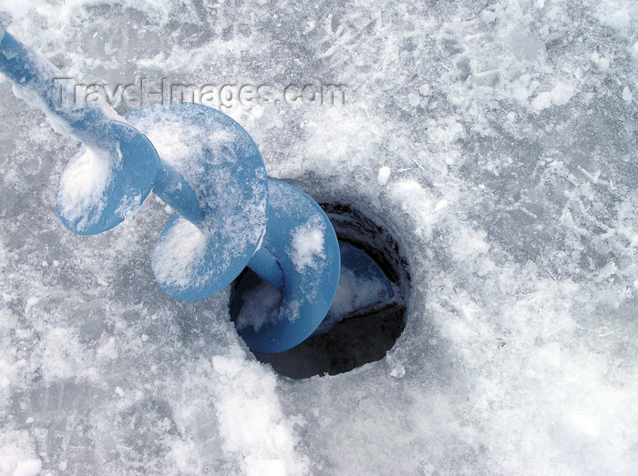 canada518: Northwest Territories, Canada: ice fishing - ice auger - hole drilled in the ice - photo by Air West Coast - (c) Travel-Images.com - Stock Photography agency - Image Bank