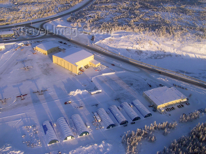 canada527: Northwest Territories, Canada: frozen aerodrome and hangars seen from the air - long shadows - photo by Air West Coast - (c) Travel-Images.com - Stock Photography agency - Image Bank