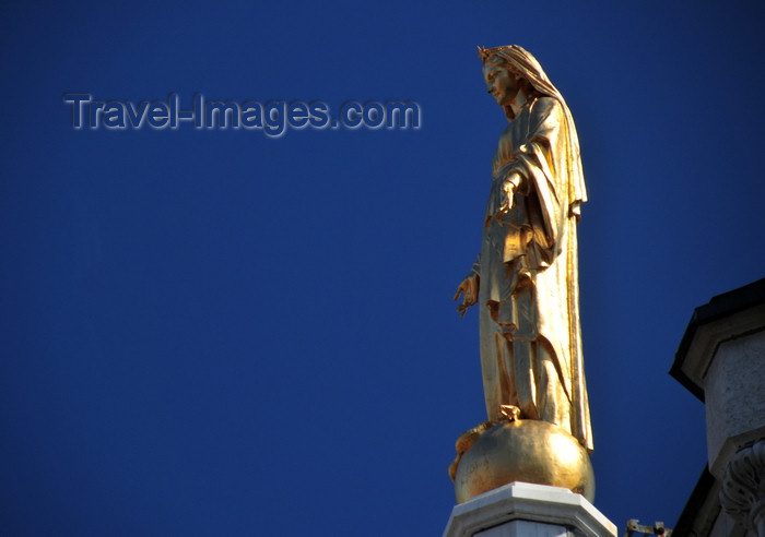 canada562: Montreal, Quebec, Canada: gilded statue of Our Lady of Lourdes atop the façade of the Chapelle Notre-Dame de Lourdes - architect Napoléon Bourassa - Rue Ste-Catherine Est, Quartier Latin - photo by M.Torres - (c) Travel-Images.com - Stock Photography agency - Image Bank