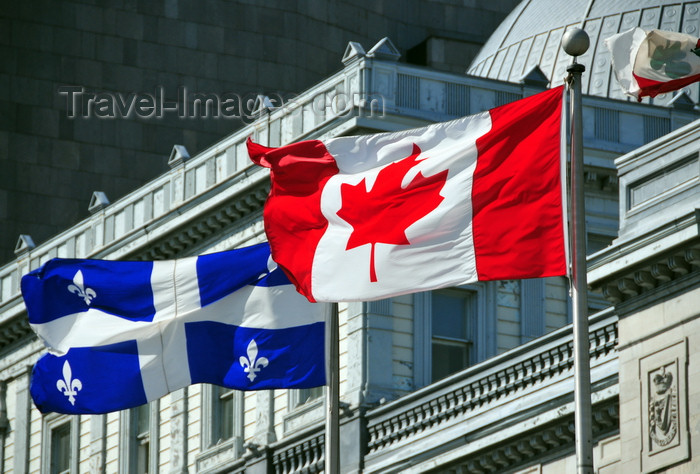 canada574: Montreal, Quebec, Canada: Canadian and Quebecer flags in front of the old Palace of Justice - Vieux palais de justice - Rue Notre Dame - Vieux-Montréal - photo by M.Torres - (c) Travel-Images.com - Stock Photography agency - Image Bank