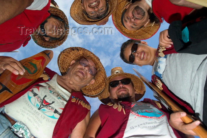 canada671: Vancouver, BC, Canada: group of North American Indians with smiling faces and wearing tradional native dress and ceremonial hats in a circle looking down at camera - Squamishnation ceremony in West Vancouver - photo by D.Smith - (c) Travel-Images.com - Stock Photography agency - Image Bank