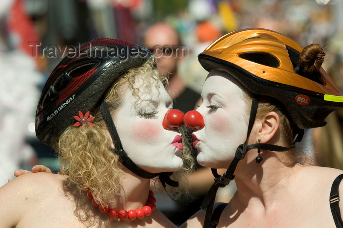 canada675: Vancouver, BC, Canada: two women with clown noses and bicycle helmets - participants in the Gay Pride Parade - photo by D.Smith - (c) Travel-Images.com - Stock Photography agency - Image Bank