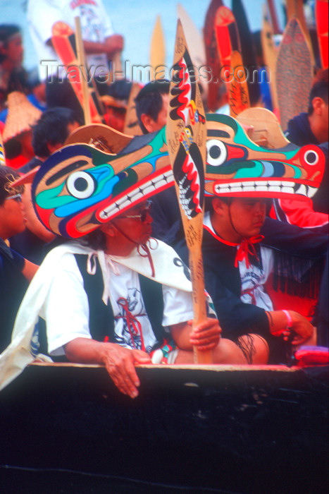 canada678: Vancouver, BC, Canada: Native North Amerian Indians wearing Indian art headgear in war canoes during canoe gathering at Capilano River, West Vancouver - photo by D.Smith - (c) Travel-Images.com - Stock Photography agency - Image Bank