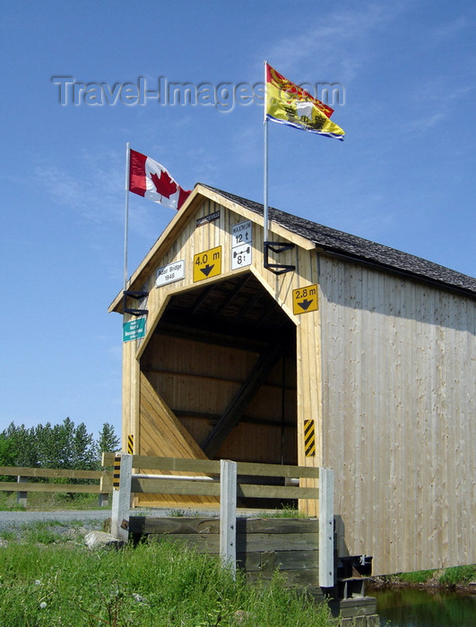 canada750: Adair, Carleton County, New Brunswick, Canada: Adair Covered Bridge - Canada and NB flags - Howe Truss - photo by G.Frysinger - (c) Travel-Images.com - Stock Photography agency - Image Bank