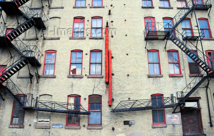 canada755: Winnipeg, Manitoba, Canada: emergency stairs - rear façade of a brick building in the Exchange District - photo by M.Torres - (c) Travel-Images.com - Stock Photography agency - Image Bank