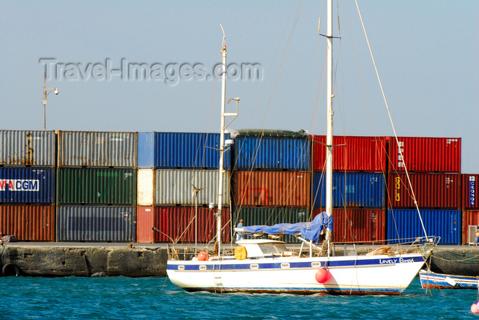 capeverde47: Palmeira, Sal island / Ilha do Sal - Cape Verde / Cabo Verde: sailing boat 'Lovely Bimba' and containers in the harbour - photo by E.Petitalot - (c) Travel-Images.com - Stock Photography agency - Image Bank