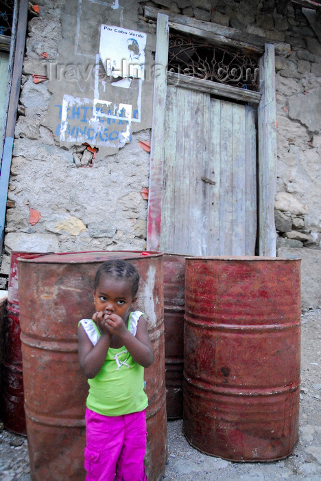 capeverde81: Fajã de Água, Brava island - Cape Verde / Cabo Verde: young girl and old fuel barrels - photo by E.Petitalot - (c) Travel-Images.com - Stock Photography agency - Image Bank