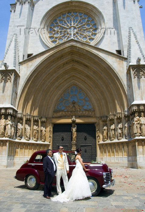 catalon120: Tarragona, Catalonia: the Cathedral - bride and groom pose with a Vauxhall Wyvern LIX 4-Door Saloon car - photo by B.Henry - (c) Travel-Images.com - Stock Photography agency - Image Bank