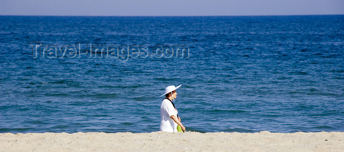 catalon135: La Pineda, Vila-seca, Costa Dorada, Tarragona, Catalonia: a woman with a large hat walks along the beach - photo by B.Henry - (c) Travel-Images.com - Stock Photography agency - Image Bank