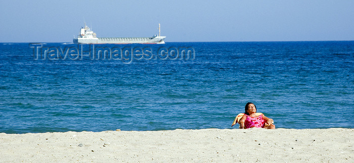 catalon137: La Pineda, Vila-seca, Costa Dorada, Tarragona, Catalonia: woman on a deck chair and a passing freighter - photo by B.Henry - (c) Travel-Images.com - Stock Photography agency - Image Bank