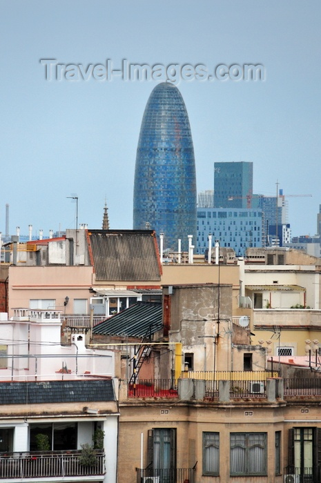 catalon211: Barcelona, Catalonia: Jean Nouvel's Agbar tower and other modern buildings seen with old residential buildings in the foreground - photo by M.Torres - (c) Travel-Images.com - Stock Photography agency - Image Bank