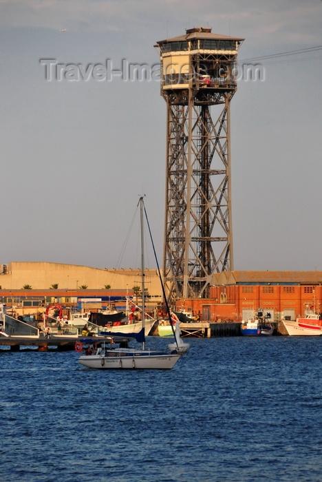 catalon257: Barcelona, Catalonia: sailing by the Torre de Sant Sebastià (1931), Port Vell Aerial Tramway - architect Carles Buïgas - Barceloneta - photo by M.Torres - (c) Travel-Images.com - Stock Photography agency - Image Bank