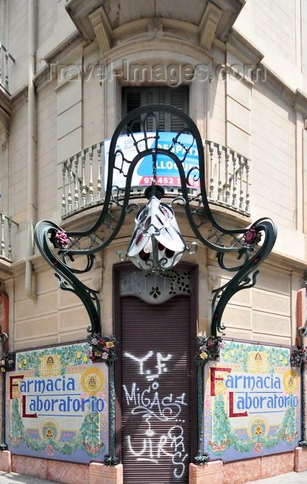 catalon270: Barcelona, Catalonia: art nouveau lamp and tiles - Farmacia Laboratorio, corner of Carrer del Bruc and Ronda de Sant Pere - photo by M.Torres - (c) Travel-Images.com - Stock Photography agency - Image Bank