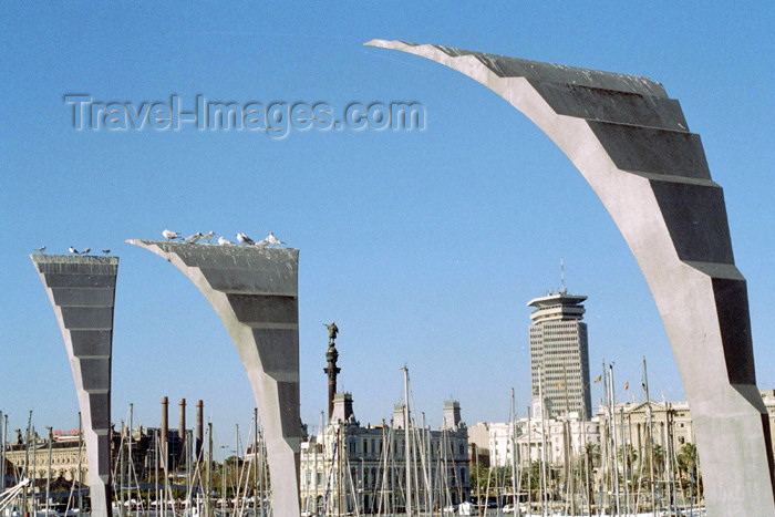 catalon86: Catalonia - Barcelona: art and guano at the marina - Edificio Colón in the background - architects Anglada i Rosselló, Ribas González, Gelabert i Fontova - photo by M.Bergsma - (c) Travel-Images.com - Stock Photography agency - Image Bank