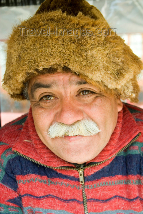 chile122: Punta Arenas, Chile: old Chilean man with mustache and wearing a beaver hat in a market stall - photo by D.Smith - (c) Travel-Images.com - Stock Photography agency - Image Bank