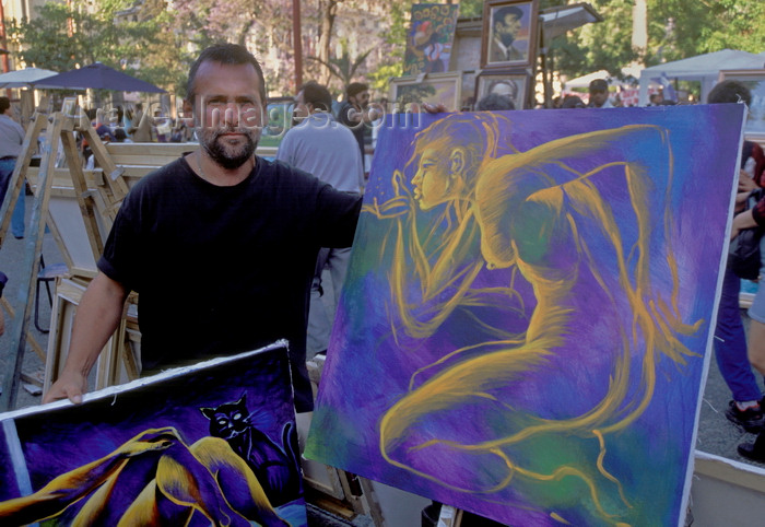 chile142: Santiago de Chile: artists display their painting in the Plaza de Armas - photo by C.Lovell - (c) Travel-Images.com - Stock Photography agency - Image Bank