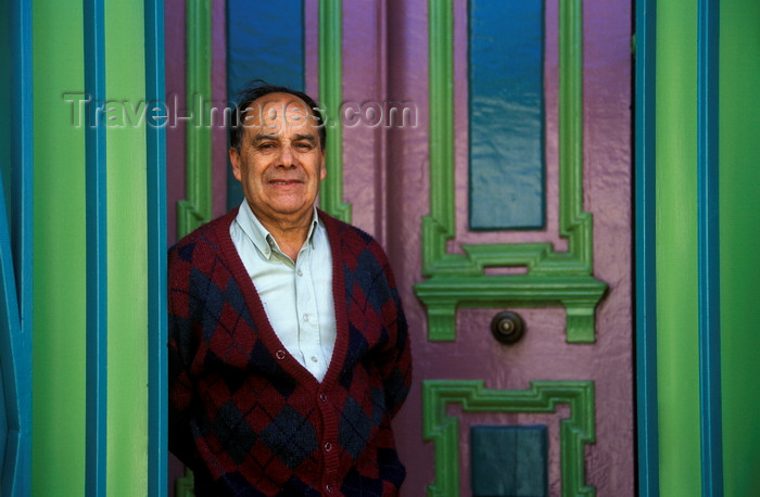 chile166: Valparaíso, Chile: Chilean man in the colorful doorway of his historic home on Cerro Conception - photo by C.Lovell - (c) Travel-Images.com - Stock Photography agency - Image Bank